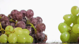 Colorful grapes in super slow motion receiving dro Stock Video Footage