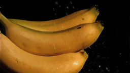 Bananas in super slow motion being wet Stock Video Footage