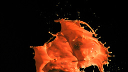 Orange paint in super slow motion splashing Footage