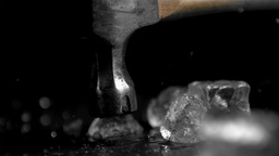 Hammer in super slow motion breaking ice cubes Footage