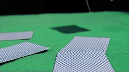 Card thrown in super slow motion on other cards Stock Video Footage