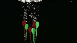 Dartboards diving in super slow motion Stock Video Footage