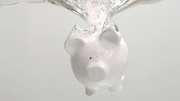 Piggybank diving in super slow motion in water Stock Video Footage