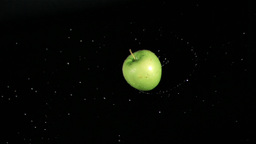 Wet green apple rotating in super slow motion Stock Video Footage