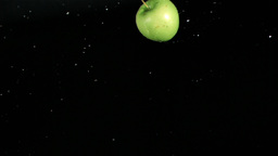 Wet green apple rotating in super slow motion Footage