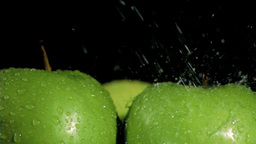Green apples being watered in super slow motion Footage