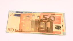 Wind blowing in super slow motion to show one hundred euro banknotes Footage