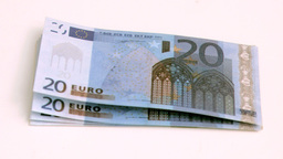 Wind blowing in super slow motion on european banknotes Footage