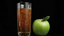 Apple juice poured in super slow motion Footage
