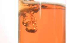 Bubbles in super slow motion in a apple juice Stock Video Footage