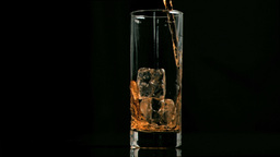 Fizzy drink poured in super slow motion in a glass Footage