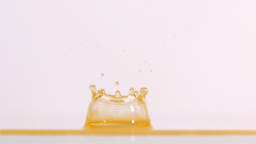 Yellow liquid splashing in super slow motion Stock Video Footage