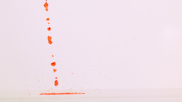 Orange liquid dripping in super slow motion Stock Video Footage