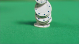 White poker chips falling in super slow motion Footage