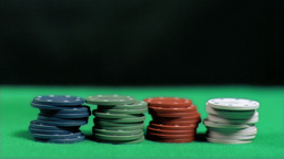 Poker chips falling in super slow motion on other Stock Video Footage