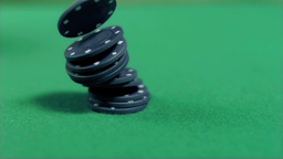 Black gambling chips falling in super slow motion Live Action