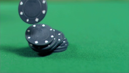 Black gambling chips falling in super slow motion Stock Video Footage