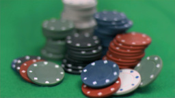 Gambling chips falling in super slow motion Live Action