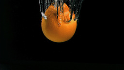 Orange falling in super slow motion into water Stock Video Footage