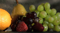 Close up of fruits watered in super slow motion Footage
