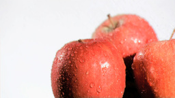 Red apple watered in super slow motion Footage