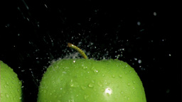 Green apples watered in super slow motion Stock Video Footage