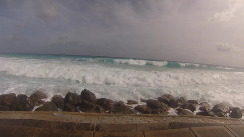 splash waves on seawalk at barbados Stock Video Footage