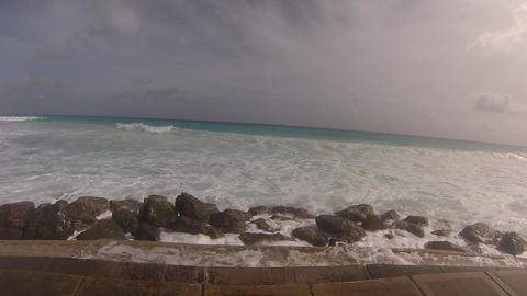 splash waves on seawalk at barbados Footage