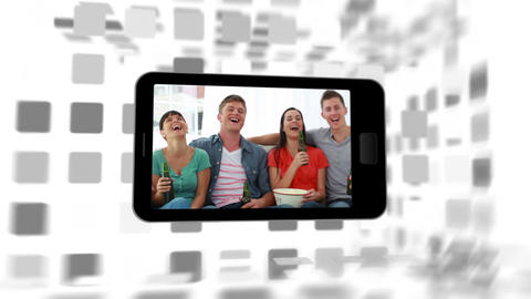 Videos of a family in living room on a smartphone Stock Video Footage