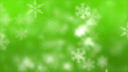 Snowflakes against green background Footage