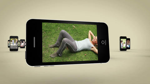 Videos of women working out on smartphone screen Stock Video Footage