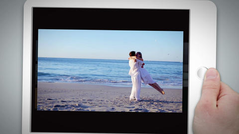Happy couple standing together on the beach Stock Video Footage