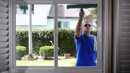 Man washing window Footage