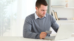 Man using a payment card online Stock Video Footage