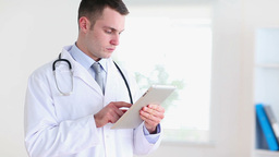 Doctor using a tablet tactile Stock Video Footage
