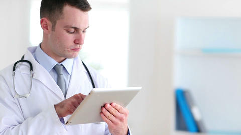 Doctor using a tactile tablet Stock Video Footage