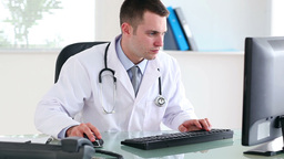 Doctor typing on a keyboard Footage