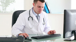 Doctor picking up the phone Stock Video Footage