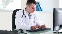 Doctor working on a computer Footage