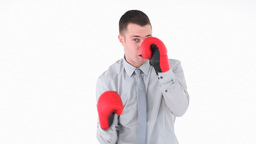 Businessman boxing with red gloves Footage