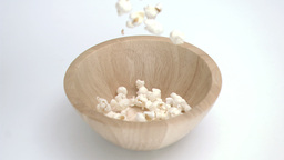 Popcorn in super slow motion falling in a bowl Stock Video Footage