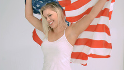 Blonde woman in slow motion raising the American f Footage