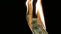 Fire in super slow motion burning a bank note Stock Video Footage