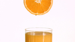 Orange in super slow motion making juice Stock Video Footage