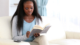 Woman reading a book Stock Video Footage
