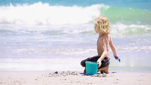 Blond kid playing on the beach Animation