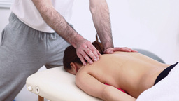 Physiotherapist massaging the shoulder blade of hi Footage