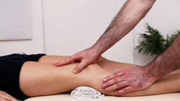 Physiotherapist massaging the thigh on a table Stock Video Footage
