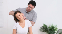 Physiotherapist massaging the neck of a woman Stock Video Footage