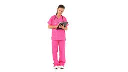 Nurse writing on a clipboard Footage